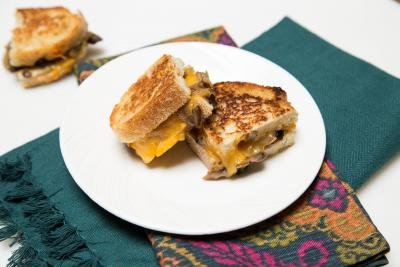 Mushroom and Cheese Sandwich cut in half on a plate