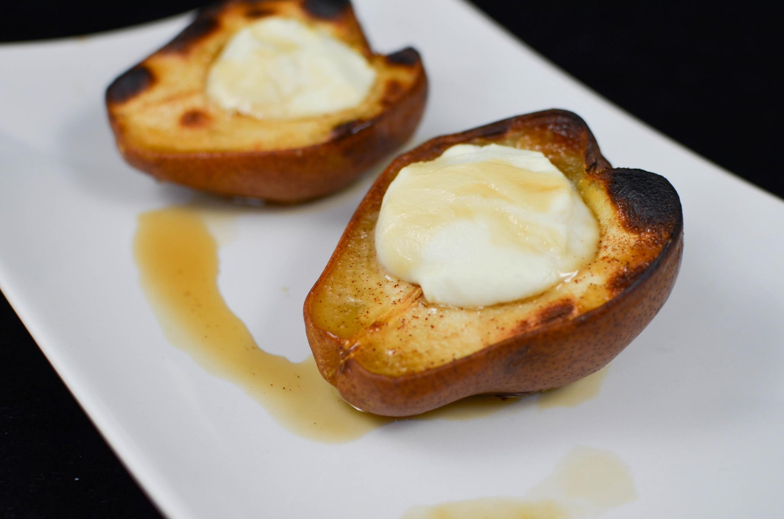 2 baked pears on a plate