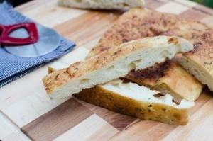 Easy Focaccia Bread cut into long thin slices on a cutting board