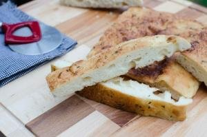 Easy Focaccia Bread cut up into long, thin slices on a cutting board