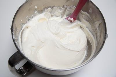 Whisked cream cheese and powdered sugar in a mixing bowl