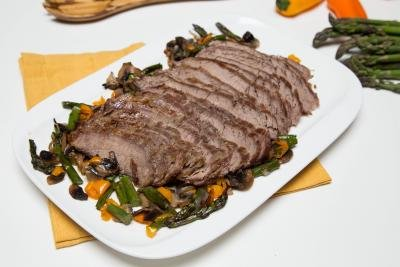Baked Steak with Vegetables on a large serving tray
