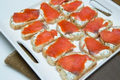 Salmon Tea Sandwiches in rows on a plate