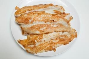 Cooked fish fillets on a plate