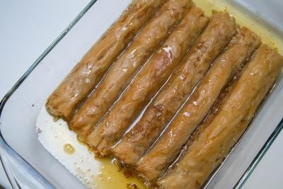 A baking pan filled with rolled baklava
