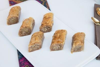 Rolled Baklava laid out in rows on a plate