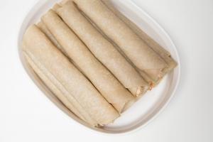 Crispy Chicken Burritos layer in a bowl