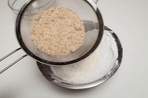 Almond flour and sugar being sifted