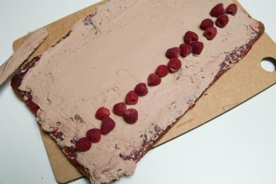 Raspberries placed inside cake roll