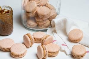 Dulce De Leche Macarons spread out on the table