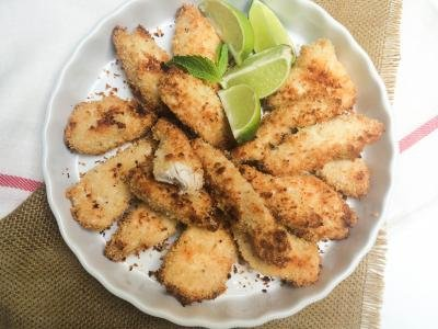 Crispy Baked Chicken Tenders on a plate with lime wedges next to them