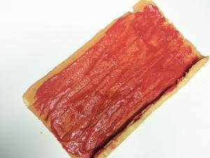 Blended strawberries spread on the cake