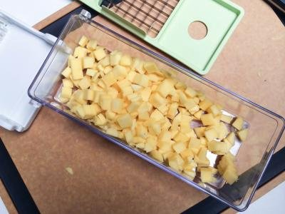 Mango being diced using a plastic veggie dicer