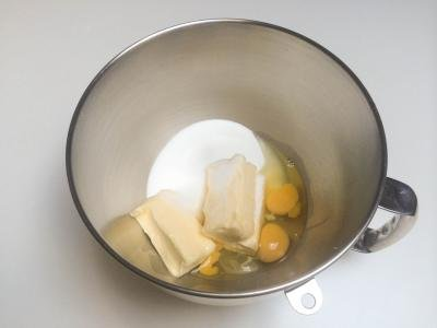 Butter, sugar and eggs in a mixing bowl