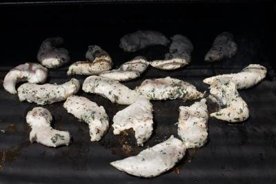 Chicken being grilled on a cookina grilling sheet