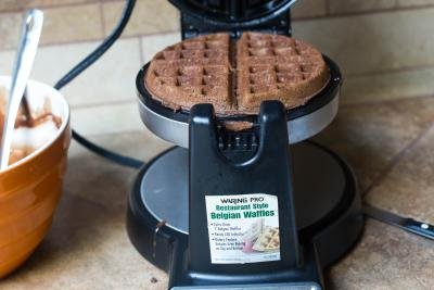 Waffle maker with a waffle in it