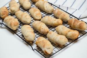 Pizza Rolls resting on a baking rack