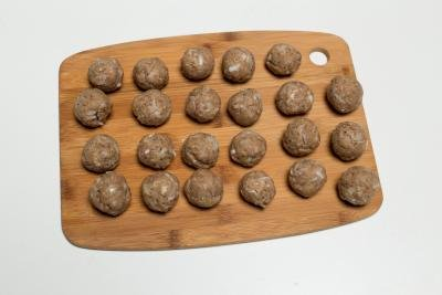 Formed meatballs on a cutting board