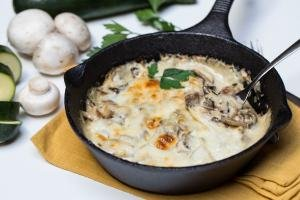 Alfredo Zucchini Bake in a small cast iron pan