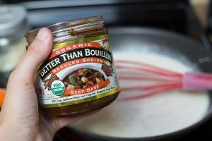 Better than Boullion beef being added to skillet with whipping cream and flour