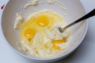 3 eggs added into sugar and butter mixture in the bowl