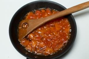 Diced tomatoes and oil in a skillet