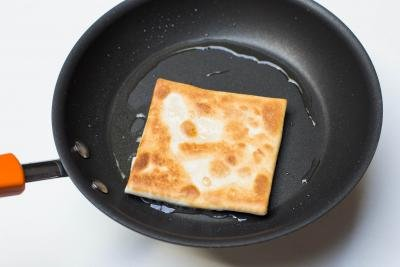 Cheesy Tortilla Pocket being fried on a skillet