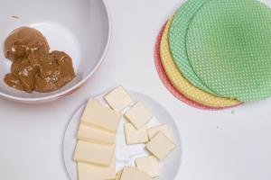 Cake wafers, a plate with butter and a bowl with dulce de leche on the table