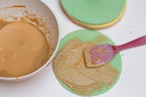 Dulce de Leche and butter mixture being spread on the waffer cake layer