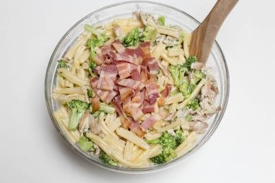 Creamy Chicken Pasta with Broccoli in a bowl with bacon added to it