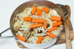Onions, carrots and turkey necks all placed into a pot
