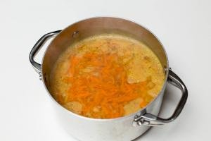 Carrots and onions added into the pot with better than bouillon