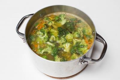 Broccoli added into the pot with soup mixture