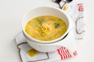 Quick Broccoli Cheddar Soup in a bowl standing on a kitchen towel