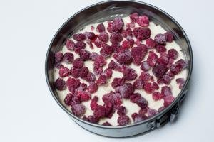 frozen raspberries placed onto the batter in the baking pan