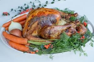 Roast Turkey with garnish all around it
