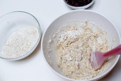 Dry ingredients being added into the mashed banana mixture