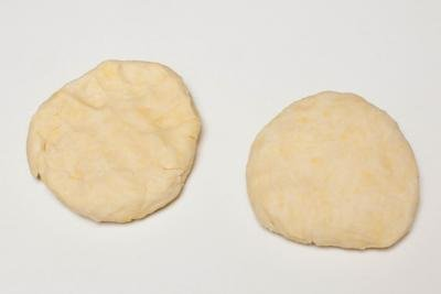 Dough divided into 2 equal pieces on the table