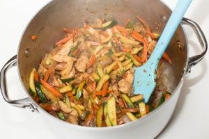 Zucchinis added into the pot with the veggies and chicken