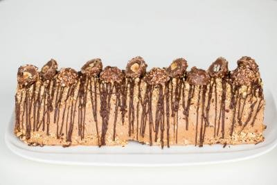 Ferrero Rocher Cake Roll on a long rectangular plate