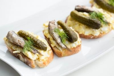 Egg & Sprats Canapes in a row on a plate