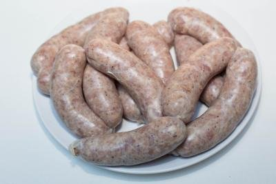 Raw sausages on a plate