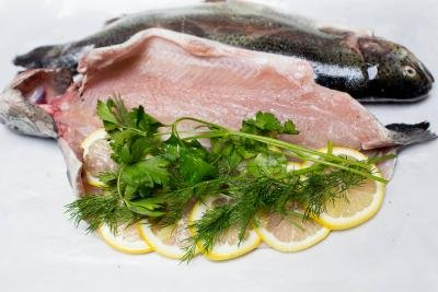 Parsley and dill added into the center of the trout