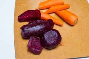 Beets and carrots on a cutting board