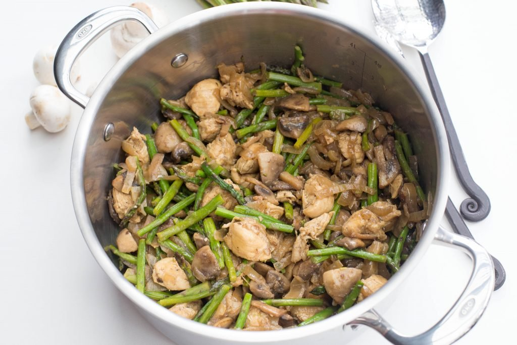Chicken and Mushrooms with Asparagus in a pot