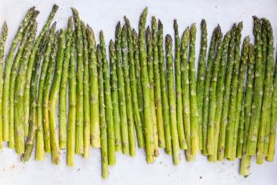 Asparagus seasoned on a baking pan