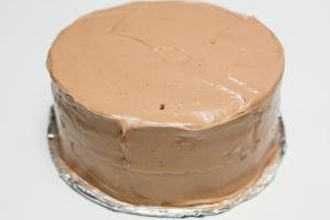 Cream spread on the top and sides of the cake