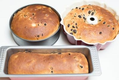 Cooked Easter bread dough in buttered baking sheet of different shapes