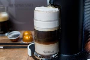 Nespresso coffee being poured into a cup