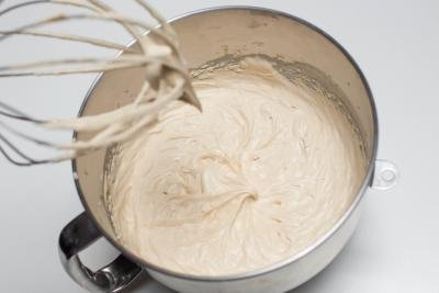 Cream mixture in a KitchenAid mixing bowl